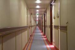 Corridor. A very long corridor in a cruise ship Stock Photos