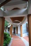 Corridor. Bending corridor in the garden of an old house Royalty Free Stock Photo