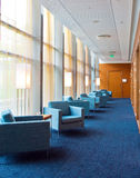 Corridor. Empty corridor with chairs and lamps Royalty Free Stock Photography