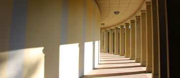 Corridor. Bright corridor with old pillars and shadows Stock Images