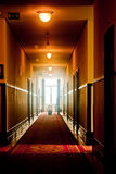 Corridor. S of a hotel with light at the end Stock Photo