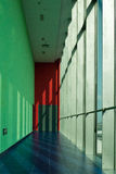 A corridor. With sunshine from the glass curtain Royalty Free Stock Photos
