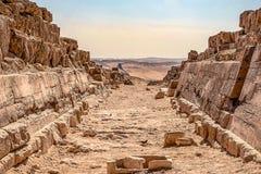 Corridor of the ancient city of Necropolis near the majestic pyramids stock photos