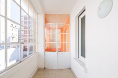 Corridor in the apartment with large windows and lots of light. Corridor in a renovated historic apartment in the city center stock photography