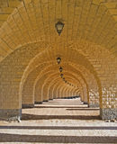 Corridor of arches. A corridor of archways leading into the distance Royalty Free Stock Images