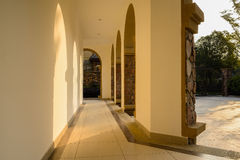 Corridor with arches on one side in sunny autumn afternoon Royalty Free Stock Photos