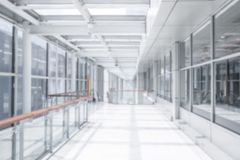 Corridor blurred background. Empty corridor or hall way with glass wall blurred background stock images
