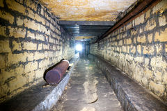 Corridor in a bomb shelter. Bunker with brick walls Royalty Free Stock Photos