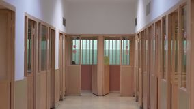 Corridor with booths for meetings with prisoners in prison.