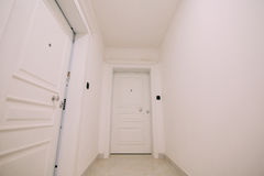 Corridor in a building. White staircase. Interior hallway with d. Oors to the neighbors Stock Images
