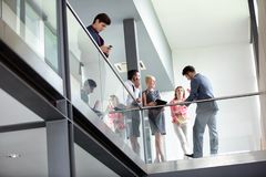 In corridor business people leisurely talking royalty free stock photo