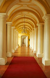 Corridor in the castle. Long corridor in the castle leading to the door Royalty Free Stock Photography