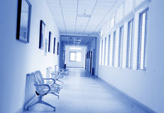 Corridor with chairs and picture frame. Blue tone,in a library Stock Images