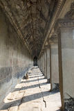 Corridor with column. In the temple wall in Angkor watu Royalty Free Stock Photography