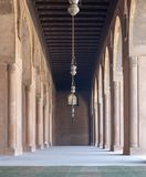 Corridor at the courtyard of the Mosque of Ahmad Ibn Tulun framed by huge decorated arches, Cairo, Egypt Royalty Free Stock Photos