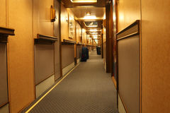 Corridor in cruise liner with doors to cabins. And sections for luggage Royalty Free Stock Images