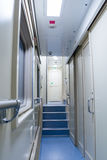 Corridor double-Decker passenger train car. The corridor on the first floor of a passenger railroad car Stock Photography