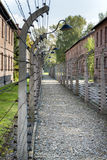 Corridor of electrified barbed-wire fences in Auschwitz II-Birkenau extermination camp Stock Photo