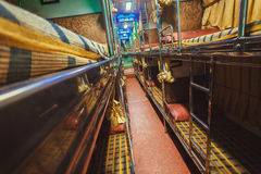 Corridor in empty sleeper bus for tourists and other passengers Royalty Free Stock Photos