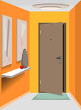 Corridor. Entrance hall with pictures on yellow walls and ajar exit door Royalty Free Stock Photography