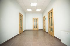 Corridor with four wooden doors Royalty Free Stock Images