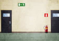 Corridor - grunge style colors. Illustration of a portion of a corridor. There are: two doors, an exit sign and a fire extinguisher Stock Image