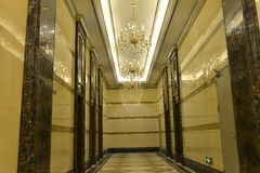 Corridor,hallway,hall,aisle. Hallway of hotel, luxury crystal lighting is  decorated on the ceiling ,China,Asia Royalty Free Stock Photos