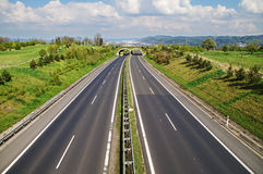 Corridor highway with the transition for wildlife, passing under ecoduct yellow truck Stock Image