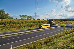 Corridor highway with yellow bus Royalty Free Stock Image