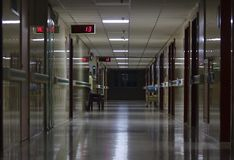 The corridor of the hospital. In the middle of the night is quiet, eerie, empty, jumping on the screen ` 13 stock image