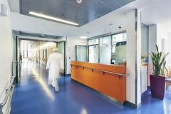 Corridor hospital reception doctor hurry. Corridor in a hospital with counter Reception Doctor with motion blur bright and sunny stock images