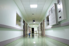 Corridor of the hospitalwith the figure of doctor Royalty Free Stock Photo