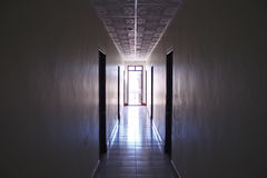 Corridor Hotel Light Rooms Concept. Photo of corridor with bright light from a street Royalty Free Stock Image