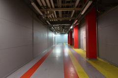 Corridor in industrial area. Wide colorful corridor between shops on a large plant Royalty Free Stock Images