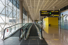 Corridor inside El Prat International Airport. BARCELONA, SPAIN - MAY 30, 2014: The airport is the second largest in Spain and 31st busiest in the world, and is Royalty Free Stock Image