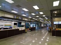 Corridor inside Taipei Songshan Airport. Taipei, Taiwan - JUNE 27, 2015: Corridor inside Taipei Songshan Airport with many service front desk on June 27,2015 in Stock Images