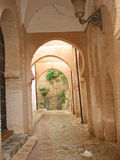 Corridor of islamic architecture. That corridor in the islamic ruins of tlemcen city in algeria stays here ,today,silent and peaceful,remaining us the fluidity Stock Photos
