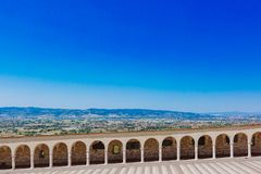 Corridor of lower square of St Francis in Assisi, Italy, with la stock image