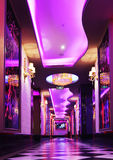 Corridor in a luxury hotel. Lit up by purple led light.decorated with crystal lighting ,wall lighting ,ceiling light and big glass picture stock photos