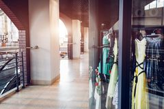 Corridor in mall. Manikins dressed in gowns on showcase of a store in shopping center. Shopping and sales concept. Spring shopping Royalty Free Stock Images