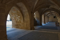 Corridor in a medieval palace in Old Town of Rhodes Stock Photos
