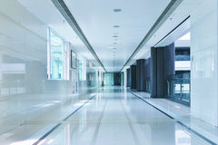 Corridor of modern office building. Empty long corridor in the modern office building royalty free stock photos