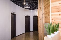 Wooden doors to the rooms in the office royalty free stock photo
