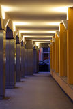 Corridor at night with lights. Walkway with ceiling lights at night fall Stock Image