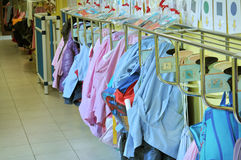 Aprons hanging in a kindergarten Stock Photo
