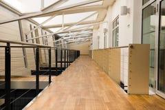 Corridor in office building. Empty clean corridor in modern office building stock photography