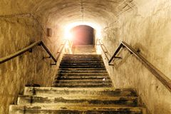 Corridor of old abandoned underground Soviet military bunker. Staircase goes up to surface.  royalty free stock photos