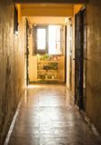 A corridor in an old cuban house. Corridor ending in a window in an old house in havanna royalty free stock photo