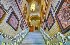 The corridor of old rug gallery, Shiraz, Iran. SHIRAZ, IRAN - OCTOBER 14, 2017: Interior of old rug gallery corridor with a staircase and examples of traditional stock photos