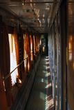 Corridor of the old train compartment. With curtains and the sun's glare Royalty Free Stock Images